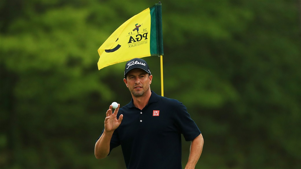 Adam Scott Raises his Pro V1 golf ball to slaute the crowd at Bethpage Black after holing a biride putt during action at the 2019 PGA Championship