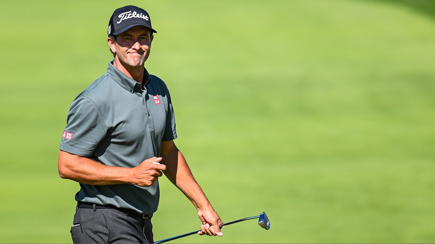 Adam Scott smiles after holing a birdie putt during action at the 2019 PLAYERS Championship