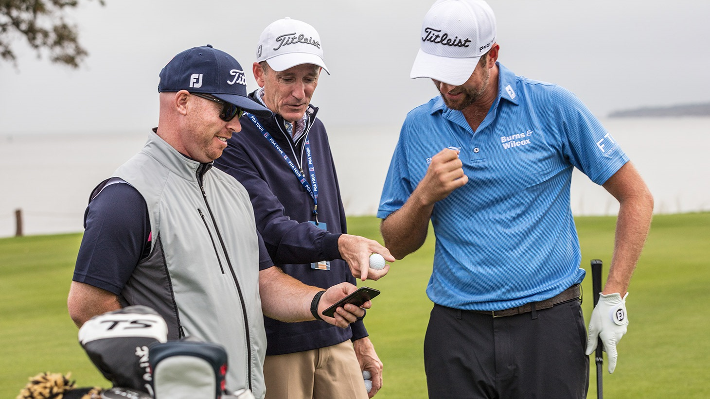 JJ Van Wiesenbeeck, Fordie Pitts and Webb Simpson discuss launch data during a golf ball fitting session at the 2019 RSM Classic