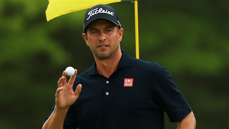 Adam Scott salutes the crowd with his Pro V1 glf ball after holing a birdie putt at the 2019 PGA Championship